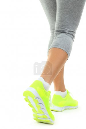 Sneakers on women legs