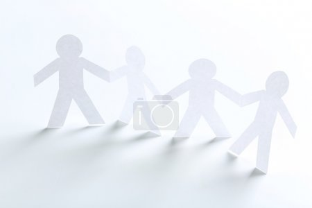 Paper people on white background