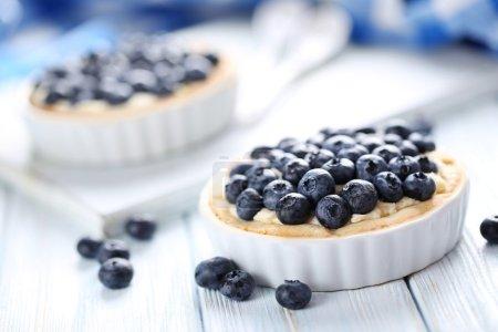 Blueberry tart on wooden table