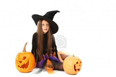 Beautiful girl witch with pumpkin