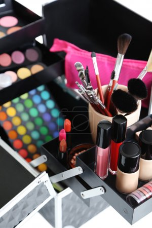 Make up case with cosmetics