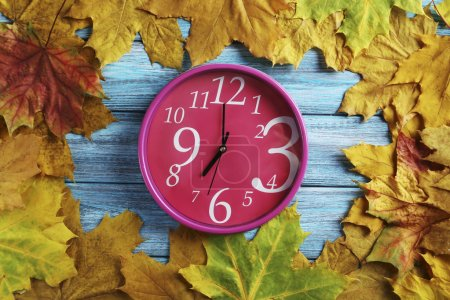 Autumn leaves  with clock