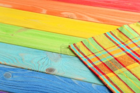 Photo for Napkin on colorful wooden table, close up - Royalty Free Image