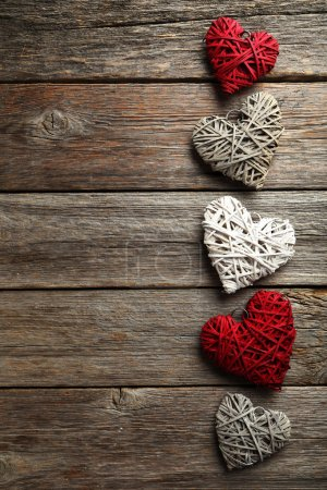 Photo for Decorative love hearts on  wooden background - Royalty Free Image