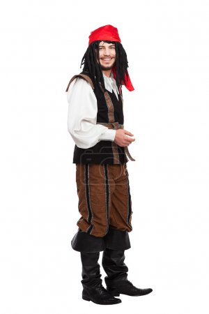 Smiling man dressed as a pirate with dreadlocks is...