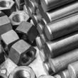 Black and white image of screws and bolts pile...