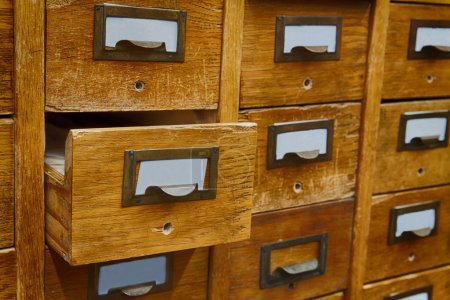 Opened box archive storage, filing cabinet interior. Vintage wooden boxes with blank index cards. library service and information management concept. soft focus