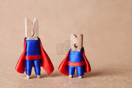 Superheroes in blue suit and red cape