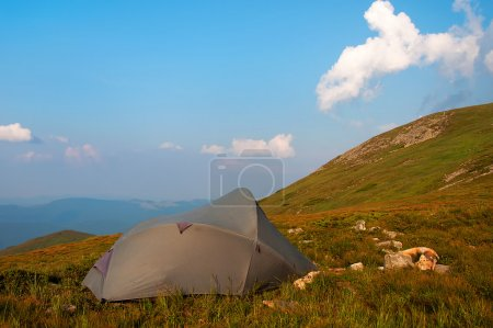 Photo for The gray tent in high mountains against the sky - Royalty Free Image