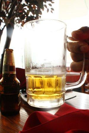 mug of beer in hand
