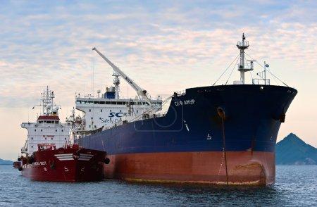 Bunkering tanker Cristal West tanker SCF Amur. Nakhodka Bay. East (Japan) Sea. 15.08.2014