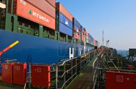 Bunkering at sea a huge container ship Hyundai companies. Nakhodka Bay. East (Japan) Sea. 19.04.2014
