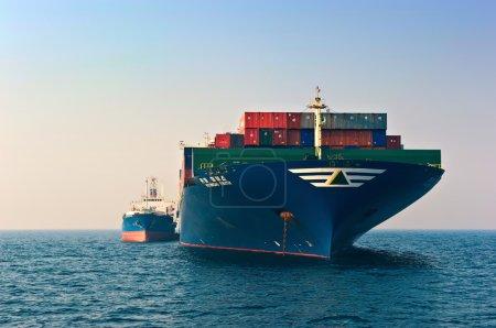 Nakhodka, Russia- 19.04.2014: Bunkering tanker Ostrov Russkiy container ship Hyundai company. Nakhodka Bay. East (Japan) Sea. 19.04.2014