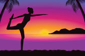Yoga in seaside at the sunset time