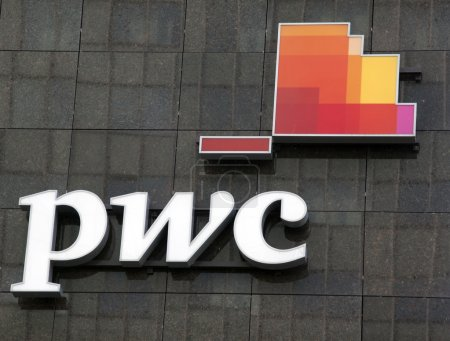 letters pwc on a wall