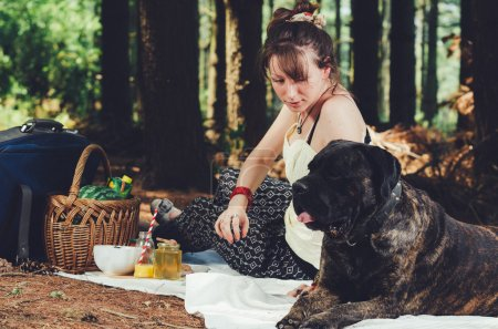 Girl on picnic with her dog.