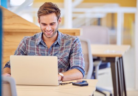 student sitting in front of laptop