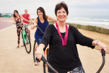 Happy family and pround mother smiling on bicycles