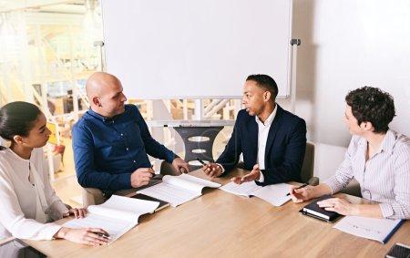 Business meeting between 4 unique individuals