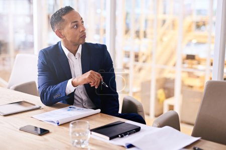 male entrepreneur sitting at a conference table