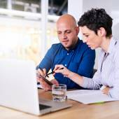 Man and mature woman working