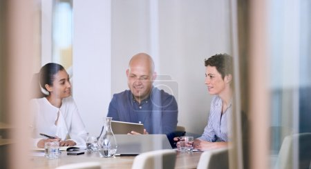 business people in discussions in office