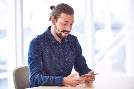 handsome man using phone