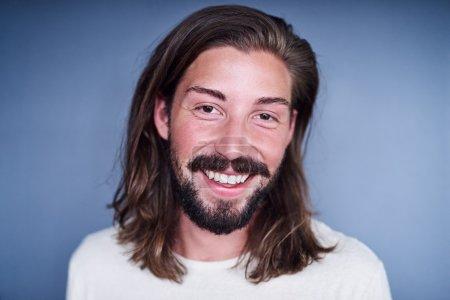 man with long loose brown hair and beard