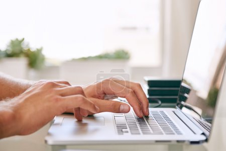 hands busy typing on a notebook with copy space