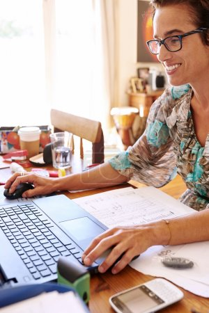 Mature self employed woman working from her home office