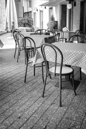 Tables and chairs. Black and white photo