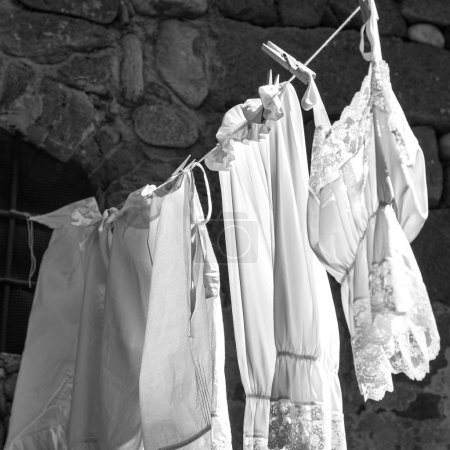 Hanging clothes. Black and white photo