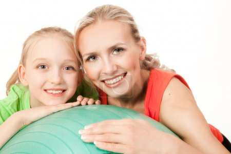 Photo for Portrait of a little sport girl with an instructor . Orange, green and black colors - Royalty Free Image