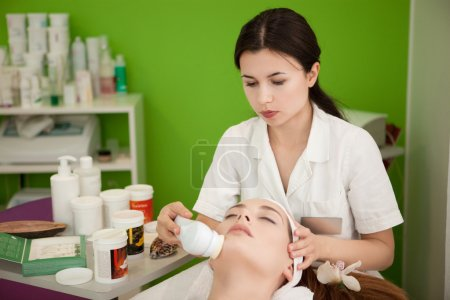 Real Beauty Therapist Making Spa Treatment for the Customer .