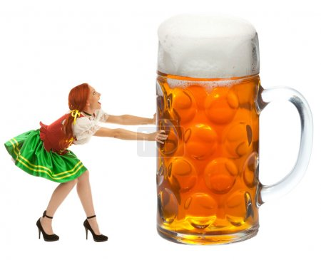 Happy Woman in Traditional Costume Pushing a Huge Beer Glass