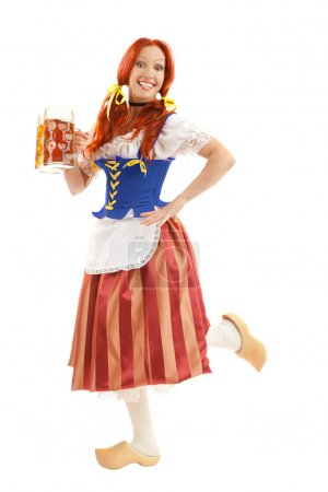 Happy Woman in Traditional Costume with Two Glasses of Beer