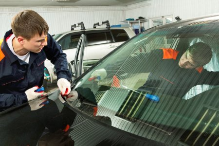 Photo for Two Real Mechanics working in Auto Repair Shop - Royalty Free Image