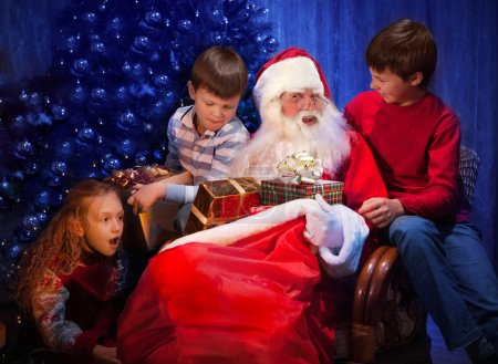 Classic Santa giving Christmas Presents to Happy Children.