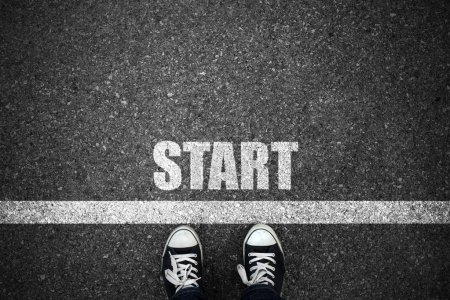 Photo for People at a starting line with start text on floor - Royalty Free Image