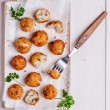 Fish croquettes on  white wooden background....