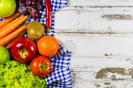 Photo for Beautiful frame of fresh fruits and vegetables on wooden table - Royalty Free Image