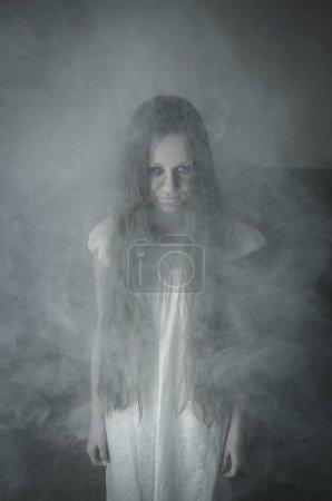 Scary horror girl in white dress...