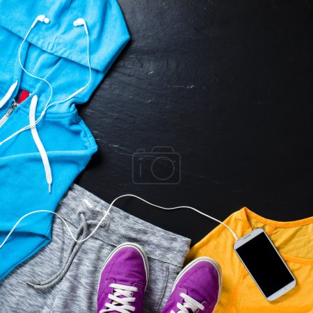 Sport clothes, shoes and mobile phone with headphones