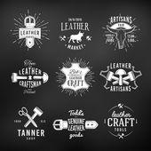 Set of leather craft logo designs retro genuine vintage tool labels artisans market insignia vector illustration on dark background