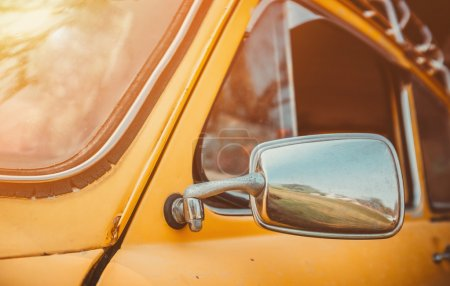 Headlight yellow vintage car.