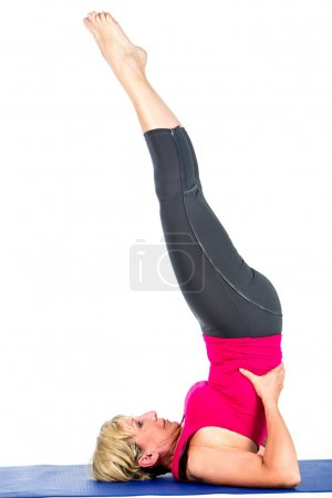 middle age woman doing yoga exercises