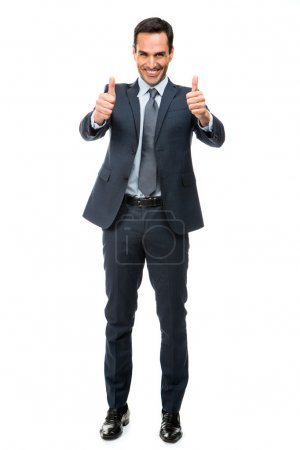 Full length portrait of a businessman smiling and pointing finger while walking