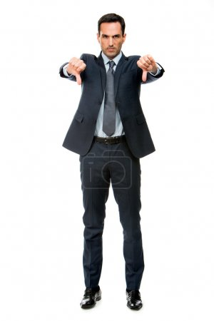 Photo for Full length portrait of a businessman looking angry and doing ko sign with both hands - Royalty Free Image