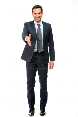 Full length portrait of a businessman smiling raising his arm for shaking hands