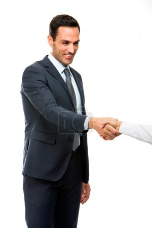 Half length portrait of a businessman smiling and shaking hand